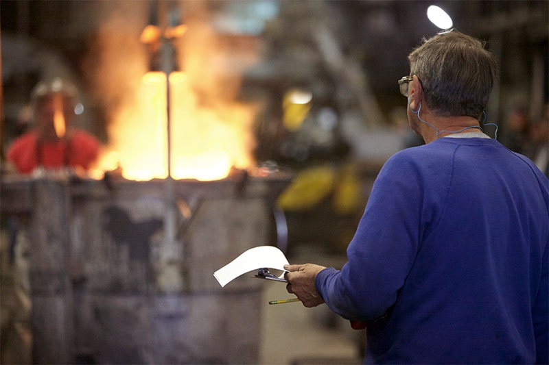 Dakota Foundry inspecting while pouring a mold