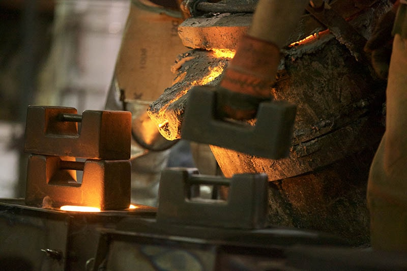 Pouring Molten Iron in mould