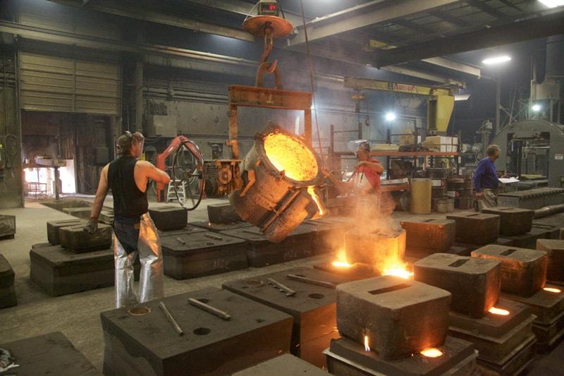 Pouring iron into molds at Dakota Foundry