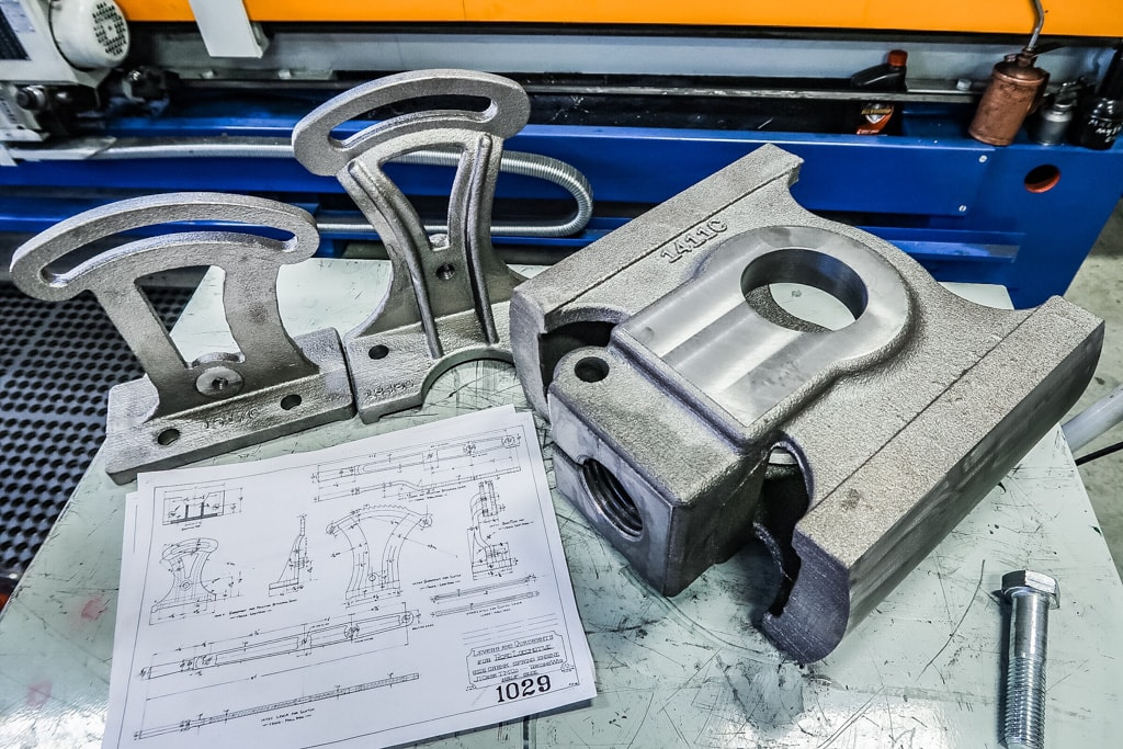 Machined crosshead and lever quadrants
