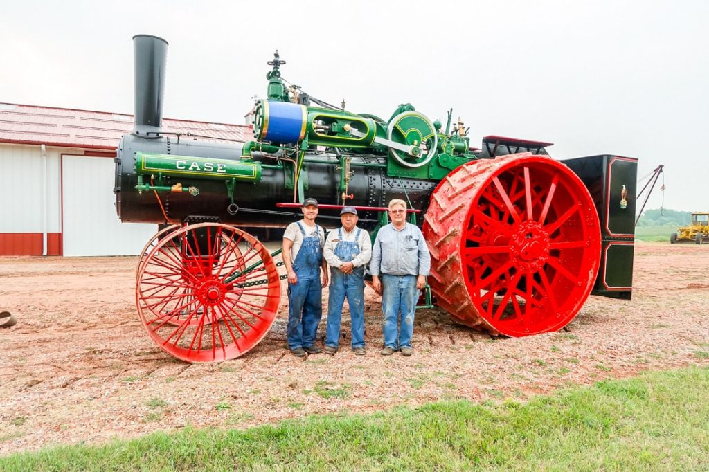 Kory Anderson, Gary Bradley and Kevin Anderson stand with the 150 HP Case steamer. After 12 years of work and a lifetime of dreaming, the engine is finally complete and ready for the trip home to Andover, South Dakota.